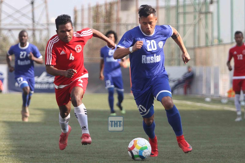 Anil Gurung (right) of Three Star Club dribbles the ball agianst Sanoths Hemrum of Nepal Police Club during their Pulsar Martyru2019s Memorial u2018Au2019 Division League match at ANFA ground in Lalitpur on Friday. Photo: Udipt Singh Chhetry
