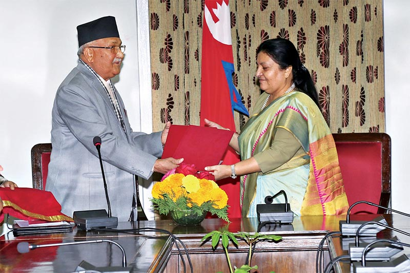 Prime Minister KP Sharma Oli handing over the annual report of National Security Council to President Bidhya Devi Bhandari, in Kathmandu, on Friday, December 14, 2018. Photo: RSS