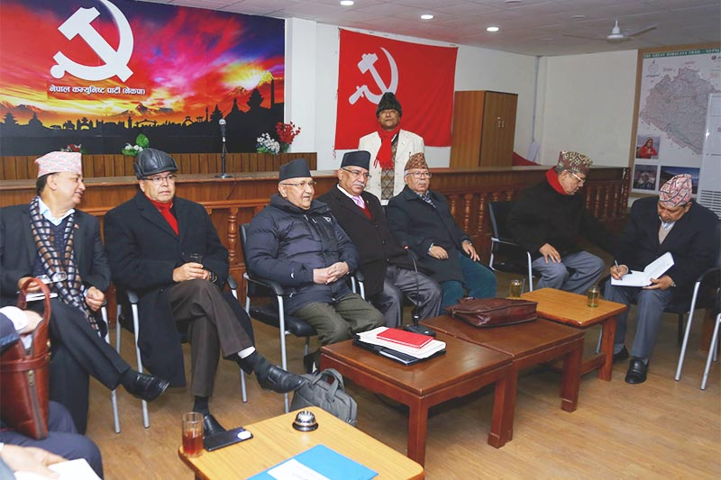 FILE - Nepal Communist Party (NCP) Chair KP Sharma Oli, Co-chair Pushpa Kamal Dahal among other leaders participate in the party's standing committee meeting held at party headquarters in Dhumrabarahi, Kathmandu, on Wednesday, December 26, 2018. Photo: RSS