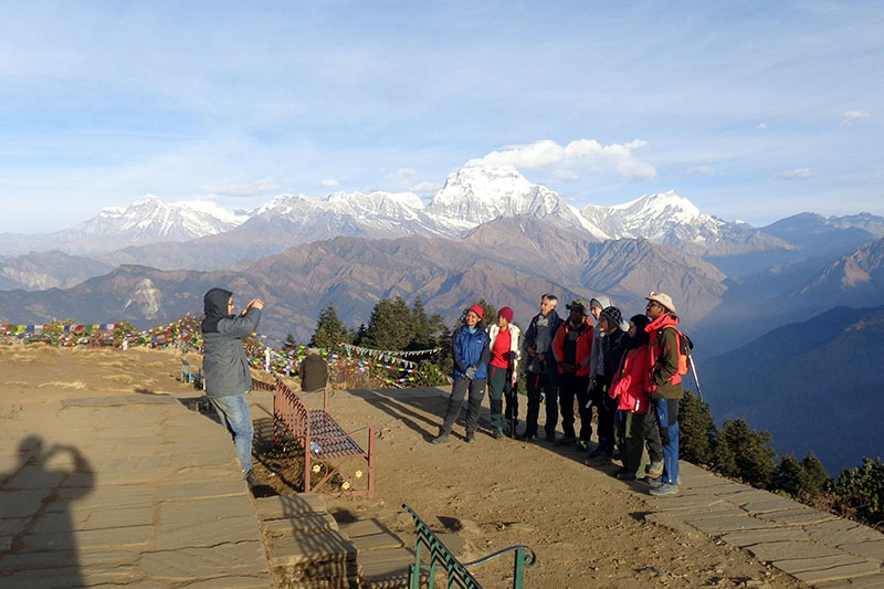 Tourists pose for a portrait at Poon Hill, which falls in Annapurna trekking route, in Myagdi district, on Thursday, December 06, 2018. Photo: RSS
