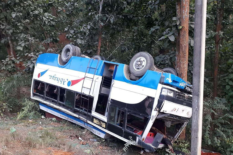 FILE: A bus turns turtle after hitting a motorbike along East-West Highway in Nawalpur district, on Tuesday, December 18, 2018. Photo: Shreeram Sigdel