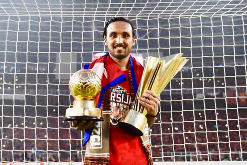 Nepali footballer Rohit Chand Thakuri poses for a portrait with a MVP player award and trophy after winning Indonesia's Liga 1 in Jakarta. Courtesy: Rohit/facebook