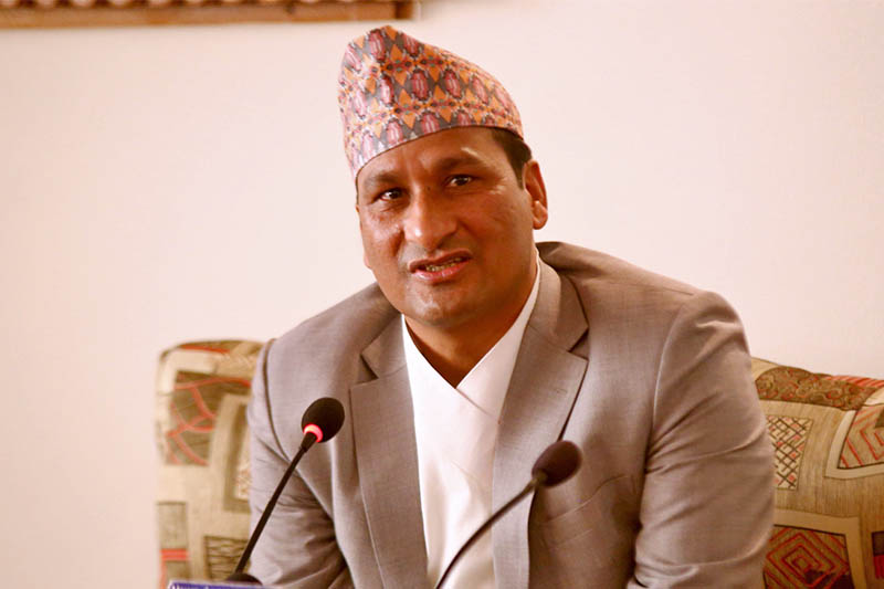 Minister for Forest and Environment Shakti Bahadur Basnet speaks to media upon arrival at TIA in Kathmandu, on Thursday, December 06, 2018. Photo: RSS