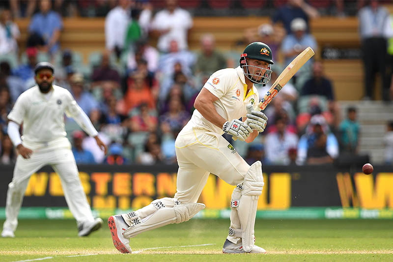Australia's Shaun Marsh plays a shot on day four of the first test match between Australia and India at the Adelaide Oval in Adelaide, Australia, December 9, 2018. Photo: Reuters