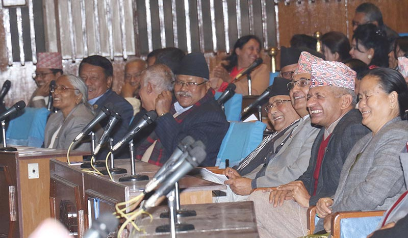 Prime Minister KP Sharma Oli and other lawmakers are all smiles on the first day of the winter session of the Parliament, in Kathmandu, on Wednesday, December 26, 2018. Photo: RSS