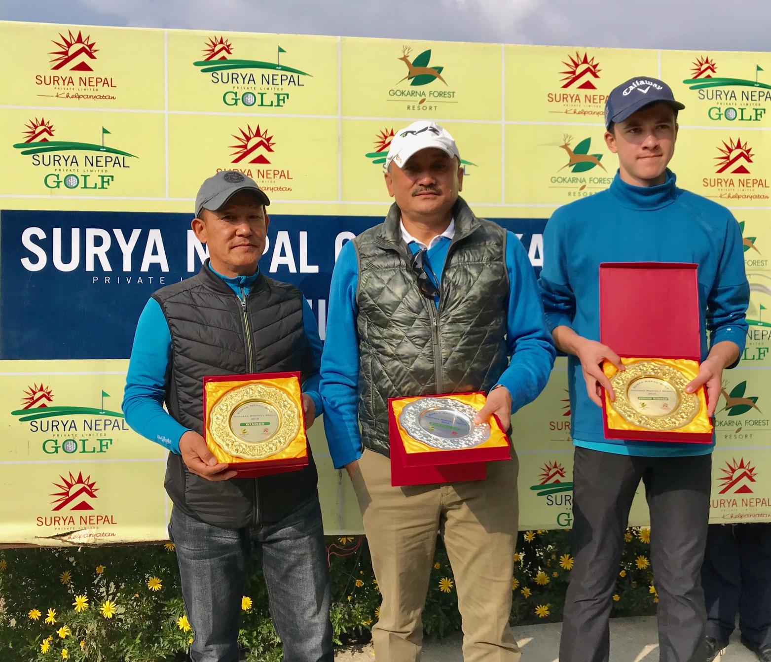 (From left) Ang Dorjee Sherpa, Pradeep Kumar Shrestha and Sam Doublard hold their trophies after the Surya Nepal Gokarna Monthly Medal here at the Gokarna Golf Club in Kathmandu on Saturday, December 8, 2018. Photo: THT