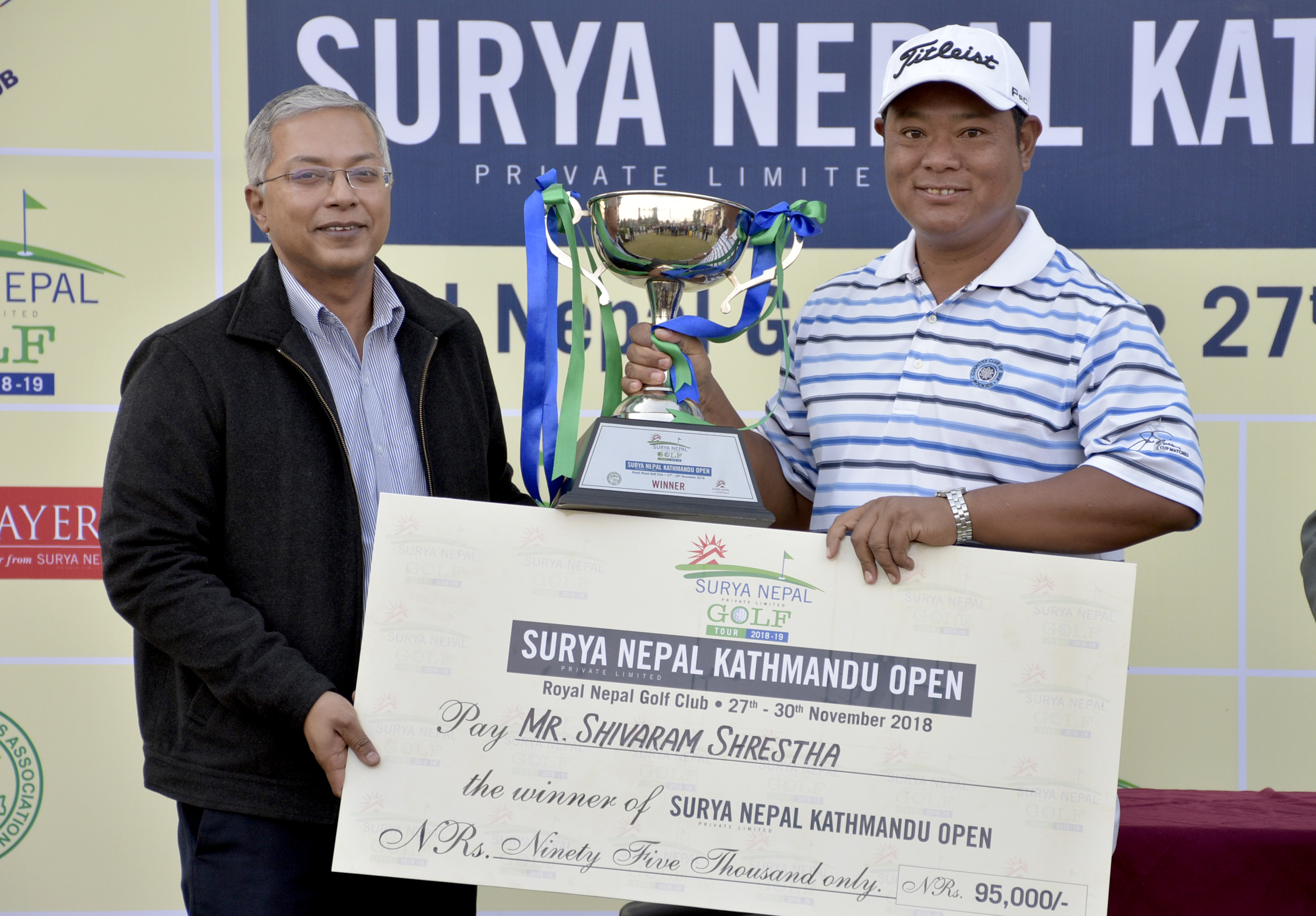 Surya Nepal Kathmandu Open winner Shivaram Shrestha (right) receives trophy and cheque from Surya Nepal Pvt Ltd Vice-president Dipra Lahiri at the RNGC on Friday, November 30, 2018. Photo: THT