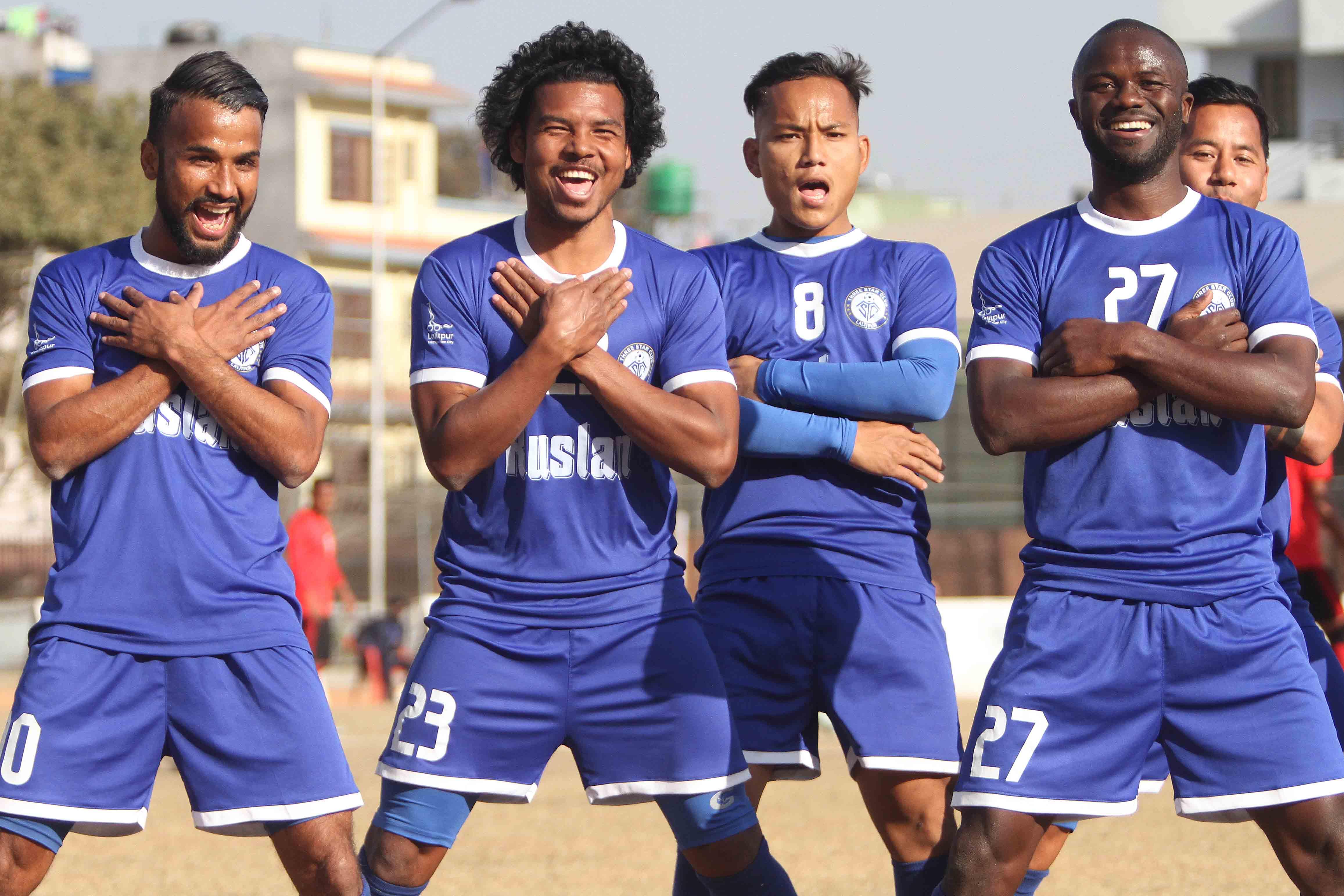 Ranjit Dhimal (second from left) of Three Star Club celebrates spot kick goal with team mates against Machhindra Football Club during their Pulsar Martyru2019s Memorial u2018Au2019 Division League match at APF Stadium in Kathmandu on Saturday. Photo: Udipt Singh Chhetry