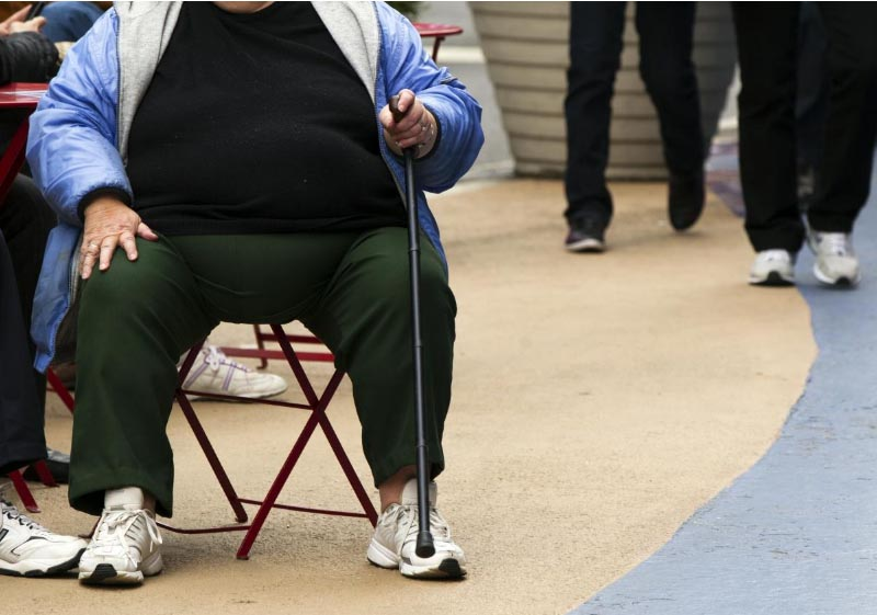 FILE - An overweight woman sits on a chair in Times Square in New York, May 8, 2012. Photo: Reuters
