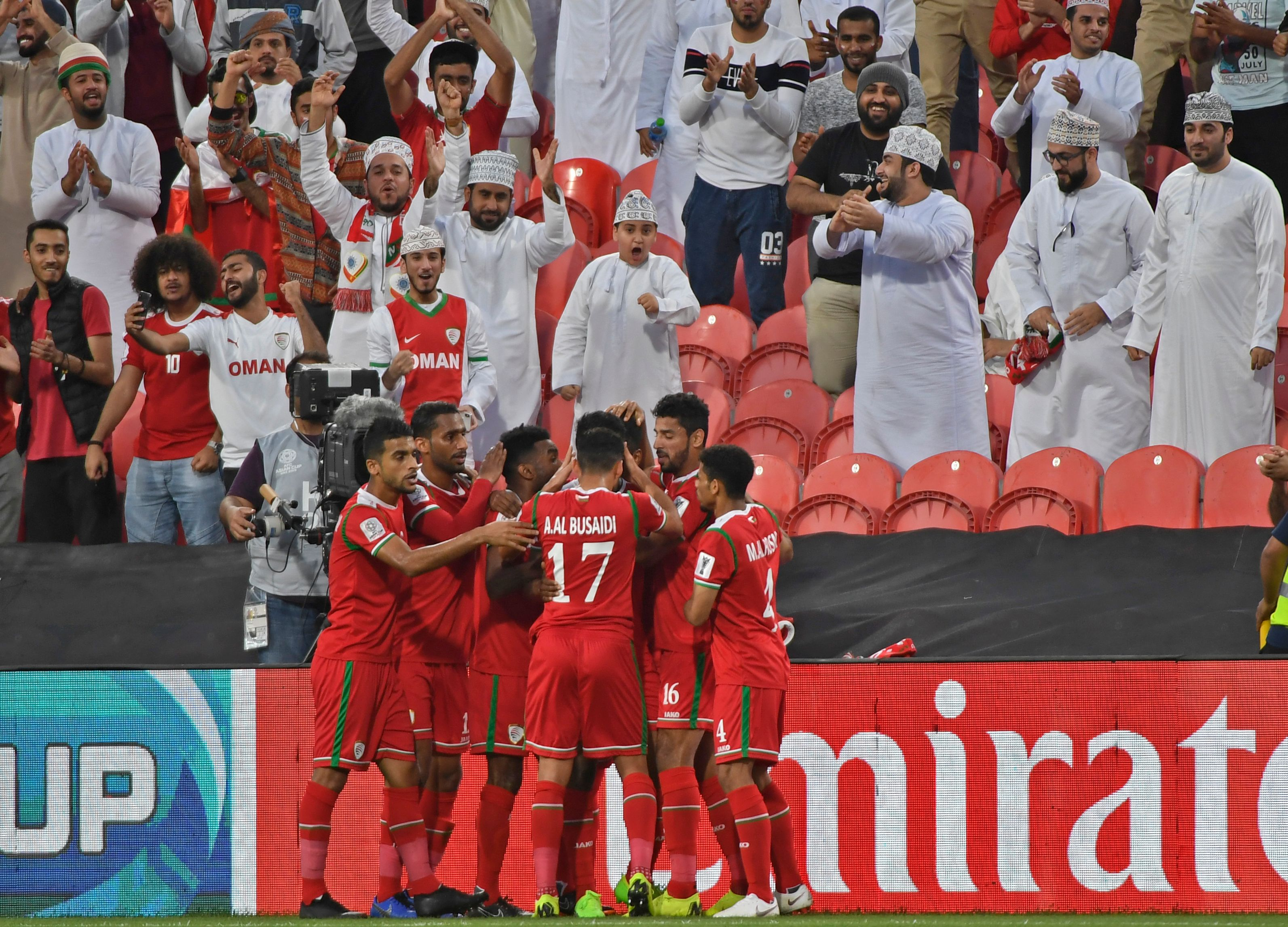 Oman's players celebrate their opening goal during the 2019 AFC Asian Cup group F football match between Oman and Turkmenistan at the Mohammed Bin Zayed Stadium in Abu Dhabi on January 17, 2019. (Photo by Khaled DESOUKI / AFP)