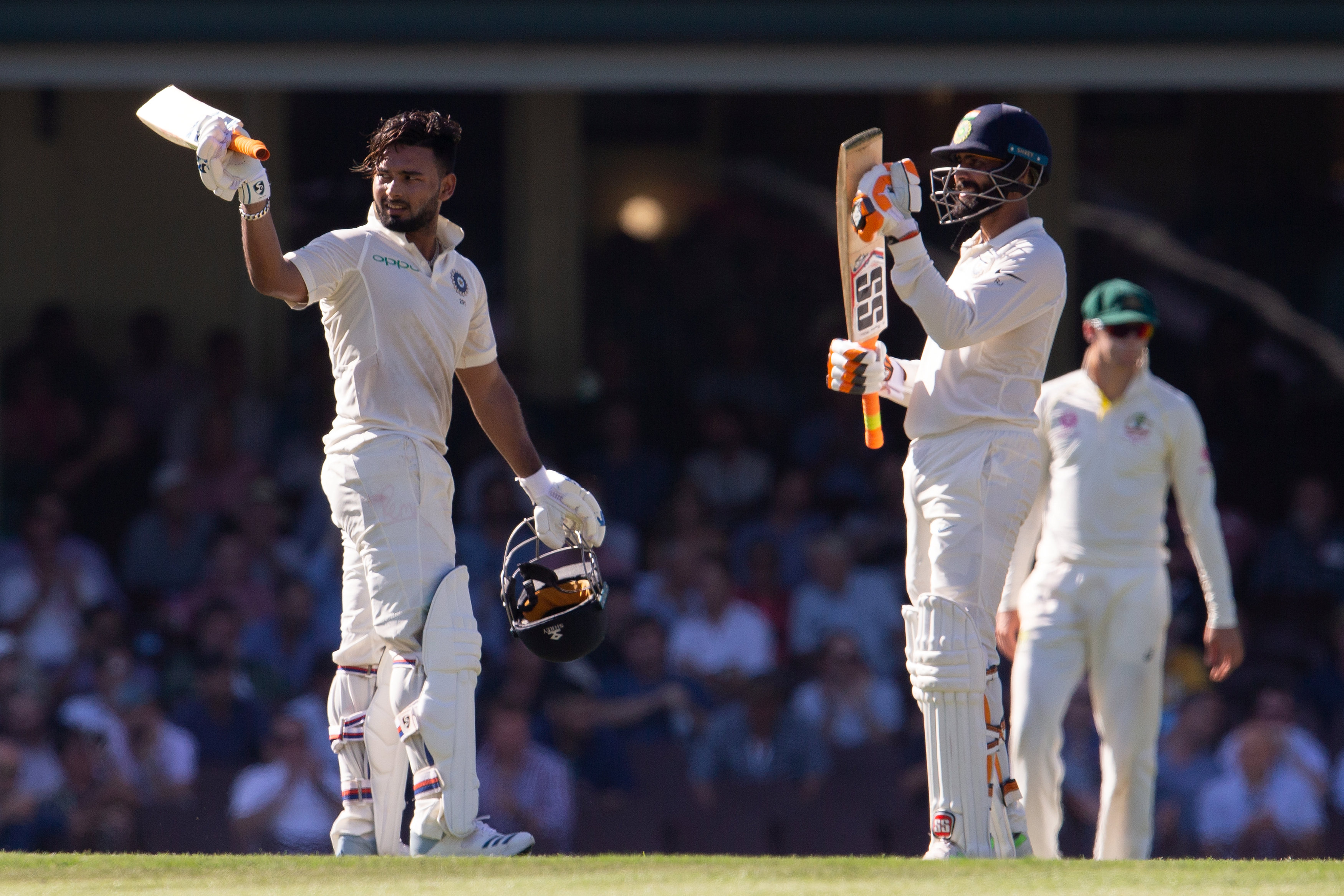India's Rishabh Pant (L) celebrates scoring his 150 runs with his teammate Ravindra Jadeja on day two of the fourth test match between Australia and India at the SCG in Sydney, Australia, January 4, 2019. Reuters