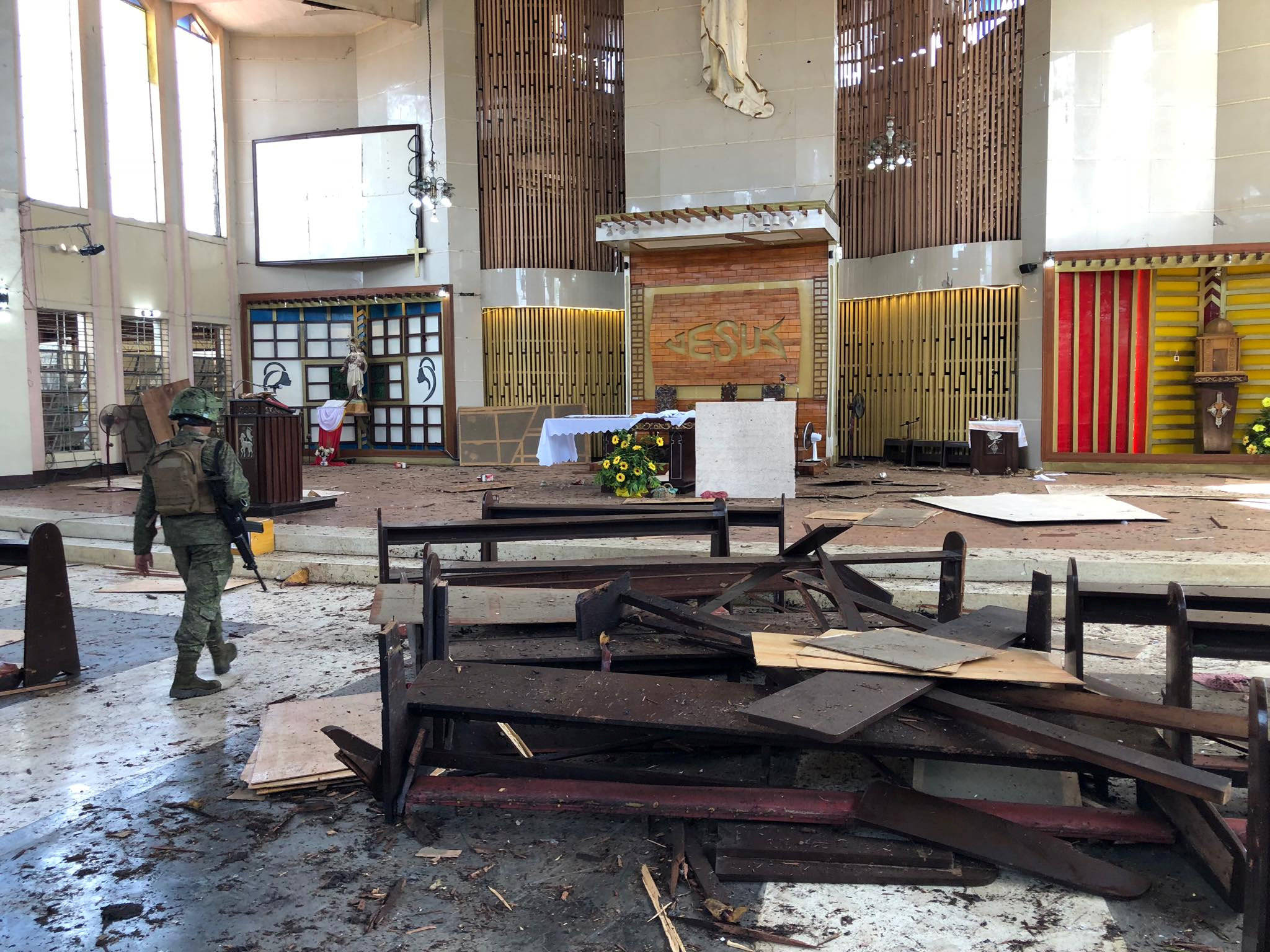 A Philippine Army member walks inside a church after a bombing attack in Jolo, Sulu province, Philippines January 27, 2019. Armed Forces of the Philippines - Western Mindanao Command/Handout via REUTERS