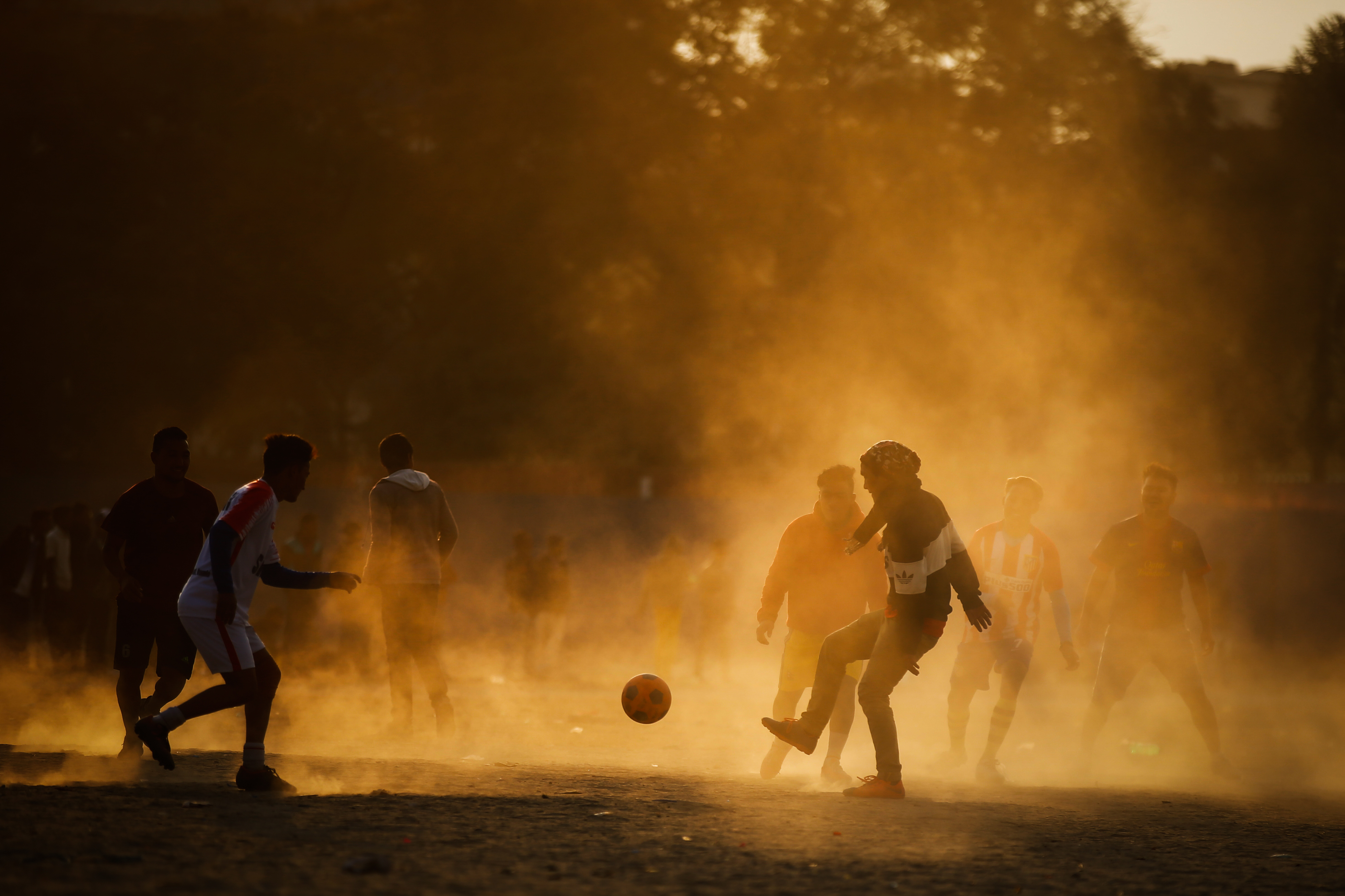 Youths play football on a dusty patch at Tundikhel ground, one of the few open spaces in Kathmandu, Nepal on Friday, January 04, 2019. Photo: Skanda Gautam/THT