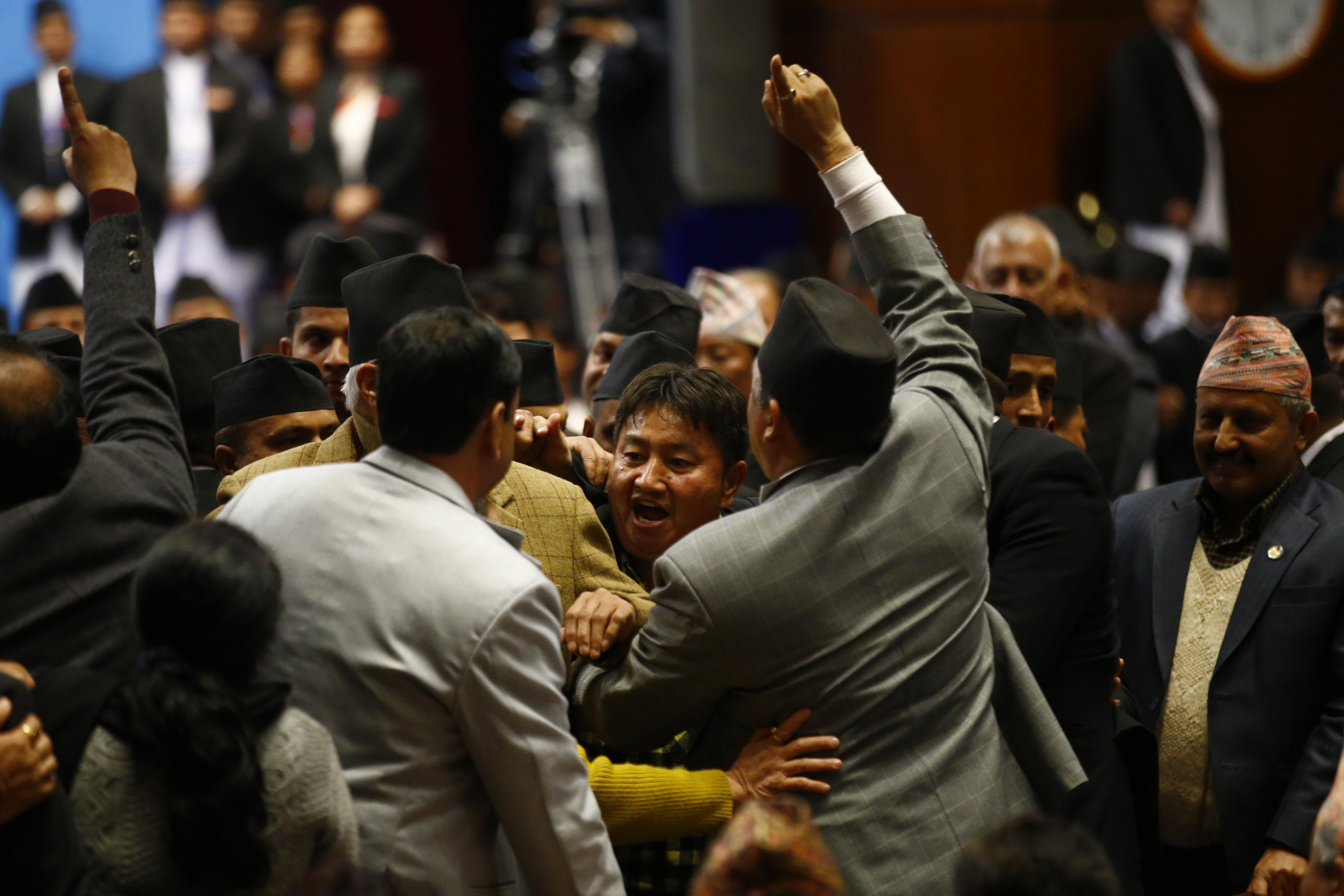 Nepali Congress lawmakers shout slogans in the well of the House of Representatives in Kathmandu, Nepal on Friday, January 25, 2019.nPhoto/Skanda Gautam