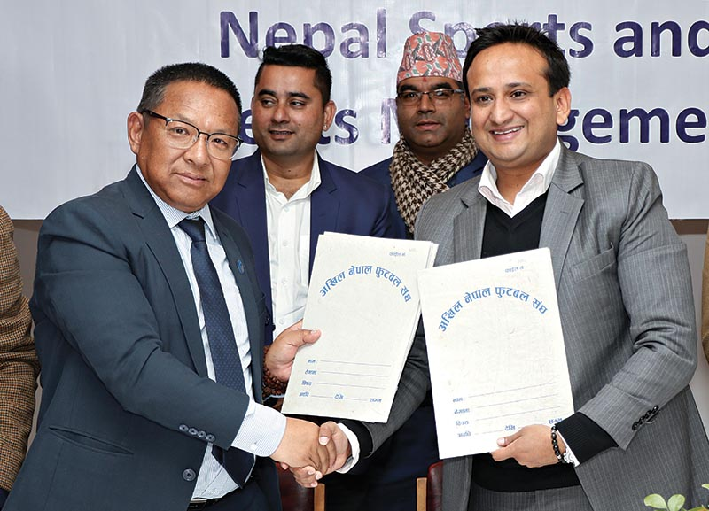 ANFA President Karma Tsering Sherpa (left) and Nepal Sports and Event Management President Nirvana Chaudhary exchanging the agreement papers in Lalitpur on Tuesday. Photo: THT