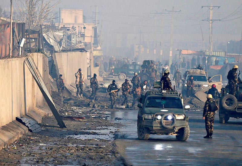 Afghan security forces inspect the site of a car bomb blast in Kabul, Afghanistan January 15, 2019. Photo: Reuters