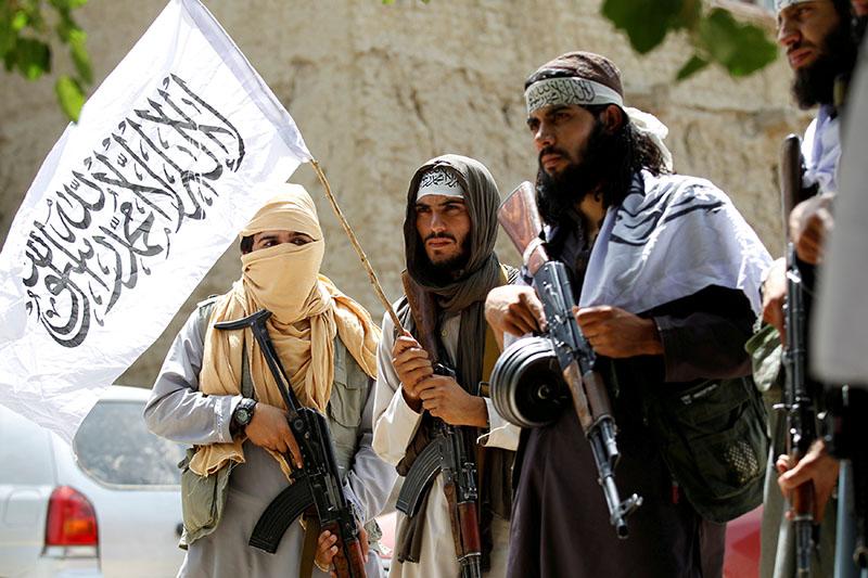 FILE - Taliban walk as they celebrate ceasefire in Ghanikhel district of Nangarhar province, Afghanistan June 16, 2018. Photo: Reuters