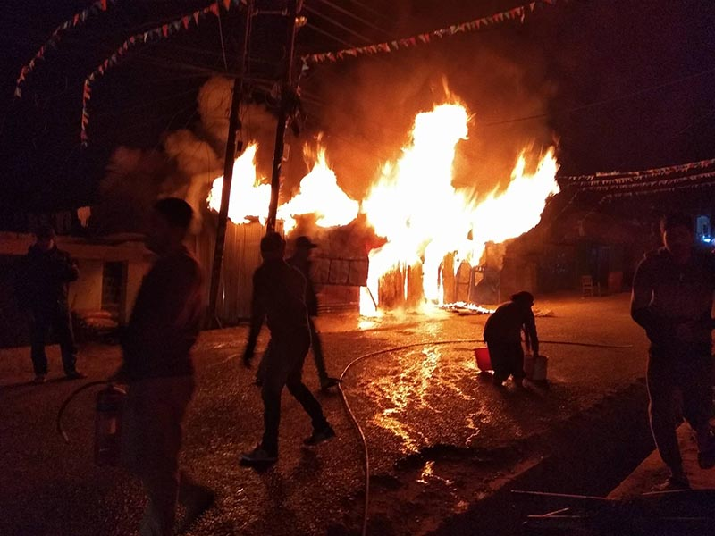 Locals trying to douse the fire that erupted in the house belonging to Lok Raj Joshi at Bagarpata Bazaar, Baghkhor of Amargadhi Municipality, Dadeldhura, on Thursday, January 3, 2019. Photo: Baburam Shrestha