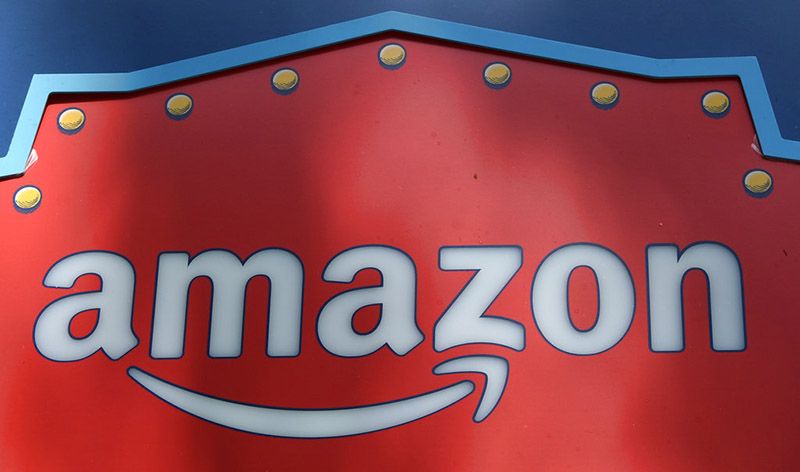 FILE - This Oct 23, 2018 file photo shows an Amazon logo atop the Amazon Treasure Truck The Park DTLA office complex in downtown Los Angeles. Amazon has eclipsed Microsoft as the most valuable publicly traded company in the US. Photo: AP