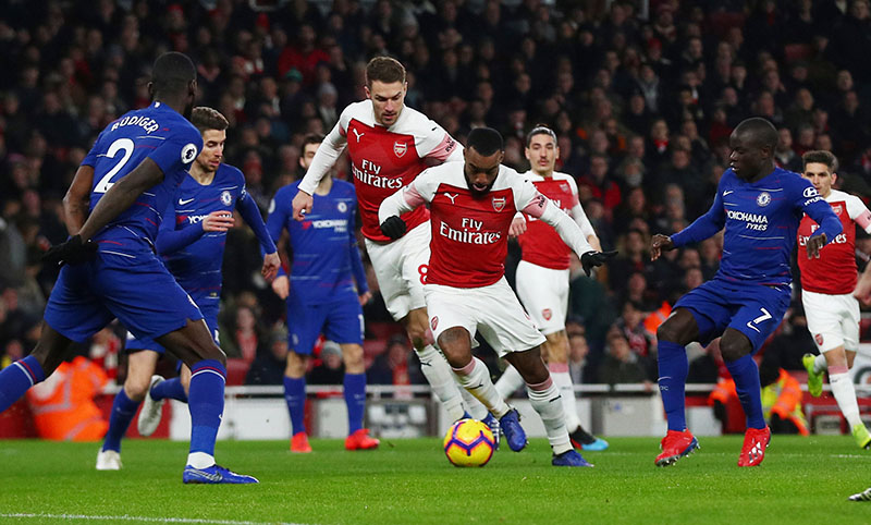 Arsenal's Alexandre Lacazette in action with Chelsea's N'Golo Kante during the Premier League match between Arsenal and Chelsea, at Emirates Stadium, in London, Britain, on January 19, 2019. Photo: Reuters
