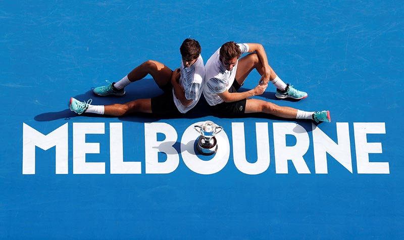 France's Pierre-Hugues Herbert and Nicolas Mahut celebrate with the trophy after winning the Australian Open Men' s Doubles Final against Finland's Henri Kontinen and Australia's John Peers, at Melbourne Park, in Melbourne, Australia, on January 27, 2019. Photo: Reuters