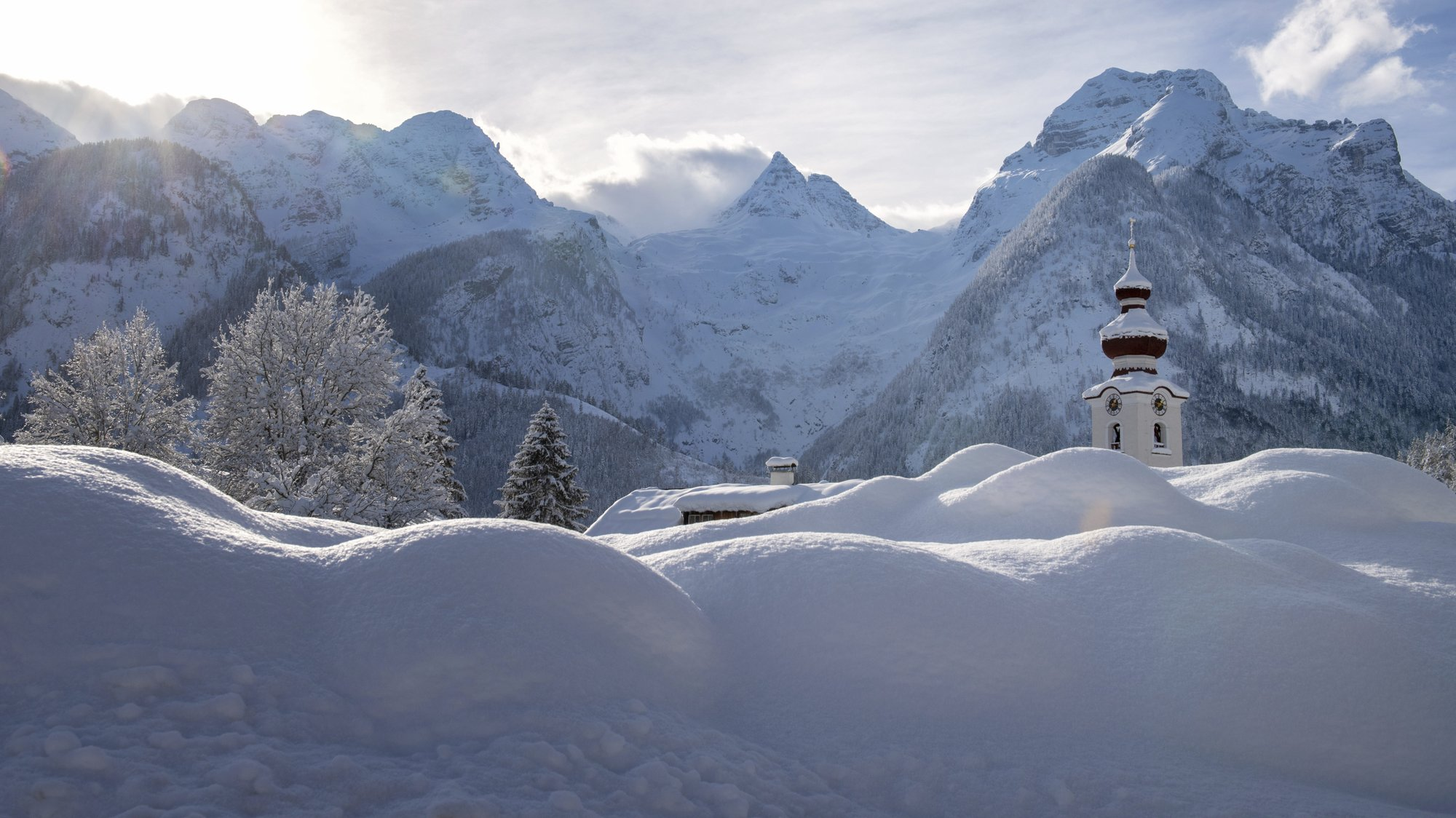 The steeple of the Loferer church is seen through the snow in Lofer, Austrian province of Salzburg on Friday, Jan. 11, 2019 after a heavy snowfall. Photo: AP