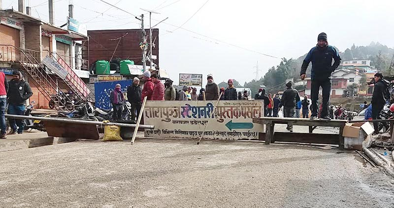 Locals obstructing vehicular movement demanding safety and security in Bagkhor, Dadeldhura, on Monday, January 7, 219. Photo: THT