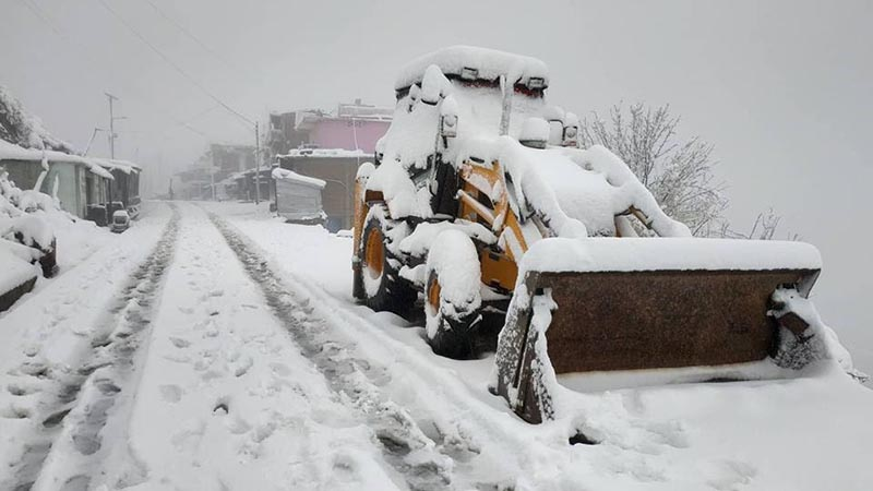 An excavator covered in snow at Khodape along the Dasarath Chand Highway in Baitadi, on Friday, January 25, 2019. Photo: THT