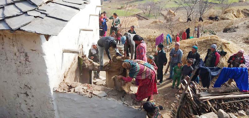 Locals pulling down the chhau shed, where a mother, along with her two sons, lost their lives, in Aghaupani, Budhinanda Municipality-9 of Bajura district, on Tuesday, January 8, 2019. Photo: THT