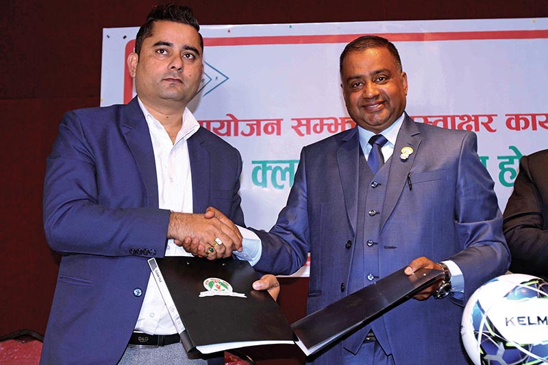 President of Bansbari Youth Club Prem Thapa (right) and Director of Spark Health Home Hospital Rupesh Adhikari exchange agreement papers during a singing ceremony in Kathmandu on Tuesday. Photo: THT