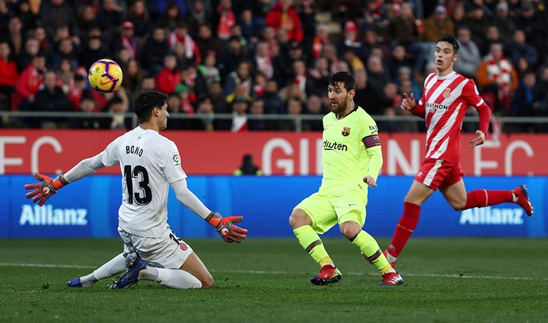 Barcelona's Lionel Messi scores their second goal during the  La Liga Santander match between Girona and FC Barcelona, at Montilivi, in Girona, Spain, on January 27, 2019. Photo: Reuters