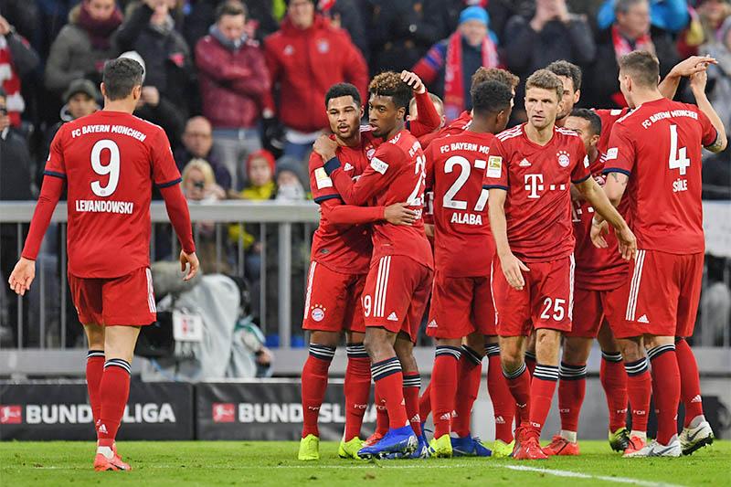 Bayern Munich's Serge Gnabry celebrates scoring their second goal with team mates. Photo: Reuters