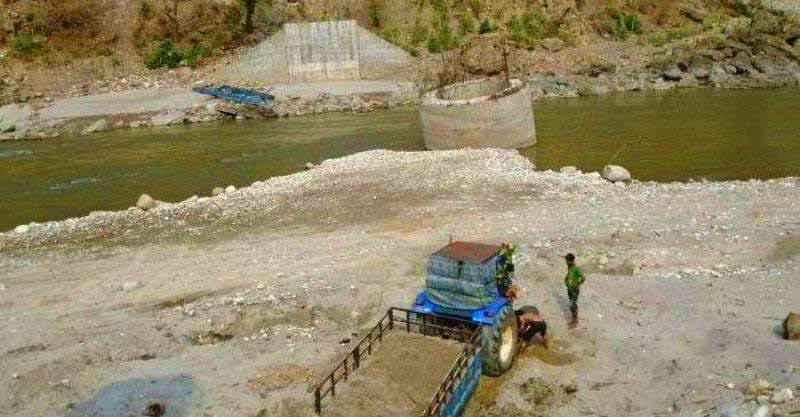 A view of an under-construction bridge over the Bheri River along the Bhurigaun-Telpani road stretch at Ranighat of Surkhet, on Wednesday, January 2, 2019. Construction work has been stalled for the past six years due to the contractoru2019s negligence. Photo: THT