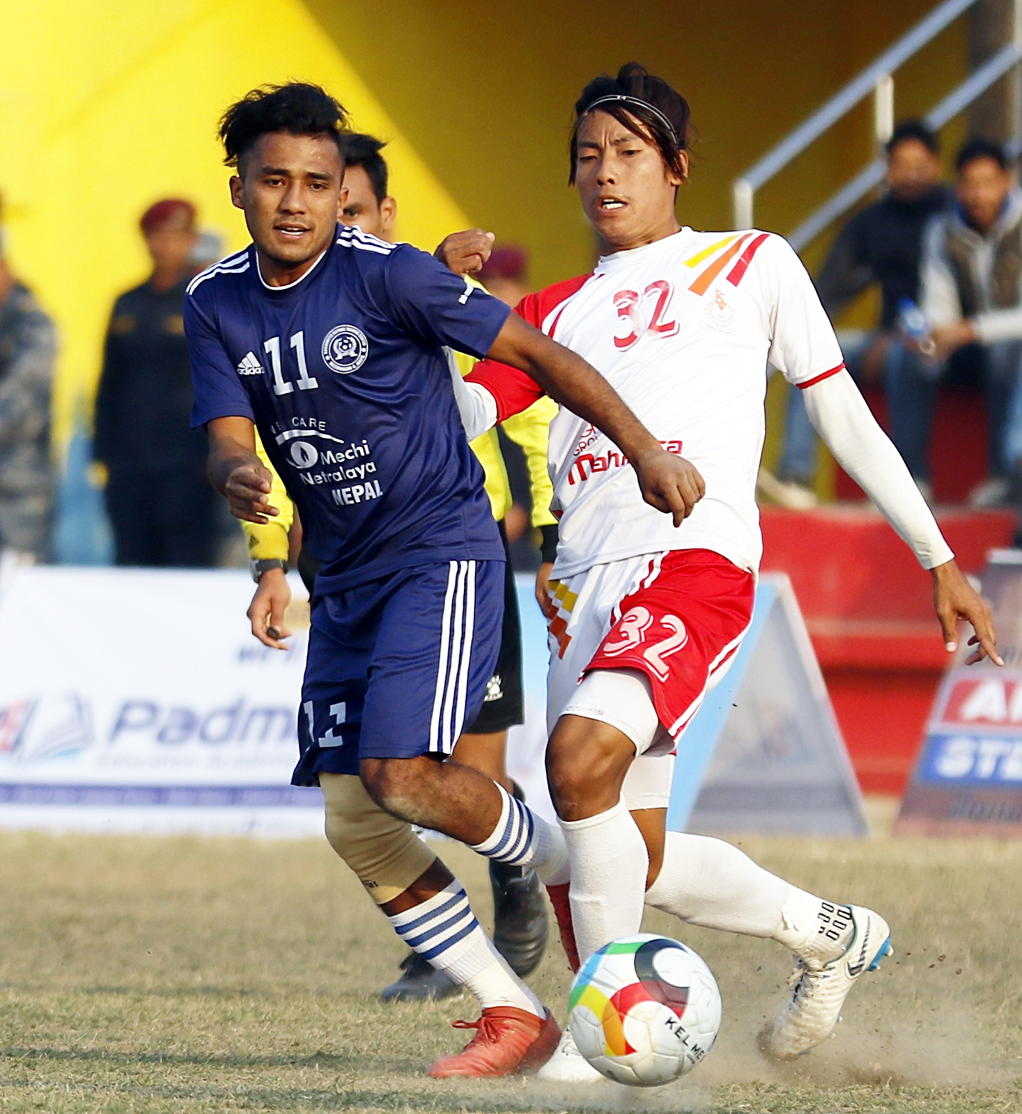 MNKFTCu2019s Bishwas Shrestha (left) vies with Nepal APF Clubu2019s Rajan Gurung during their Nepal Ice Farwest Khaptad Gold Cup match in Dhangadhi on Saturday.