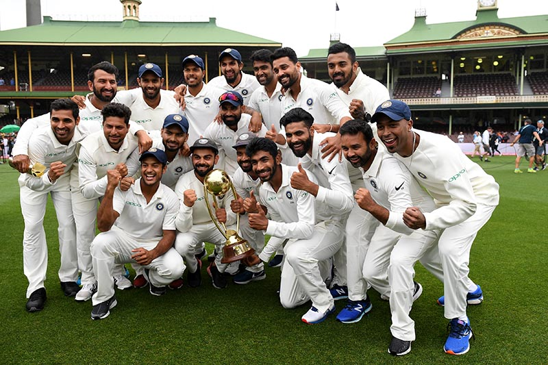 The Indian team poses for a photograph with the Border-Gavaskar Trophy as they celebrate a 2-1 series victory over Australia following play being abandoned in the fourth test match between Australia and India at the SCG in Sydney, Australia, January 7, 2019. Photo: AAP/Dan Himbrechts/via Reuters