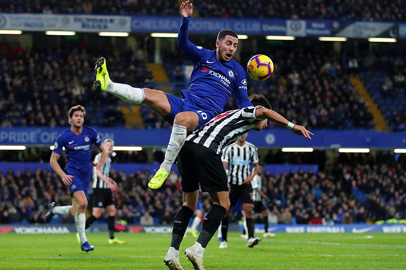 Chelsea's Eden Hazard in action with Newcastle United's Ayoze Perez during the Premier League match between Chelsea and Newcastle United, at Stamford Bridge, in London, Britain, on January 12, 2019. Photo: Reuters