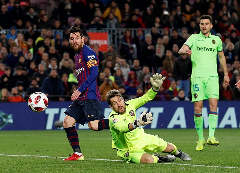 Barcelona's Lionel Messi scores their third goal during the Copa del Rey Round of 16 Second Leg match between FC Barcelona and Levante, at Camp Nou, in Barcelona, Spain, on January 17, 2019. Photo: Reuters
