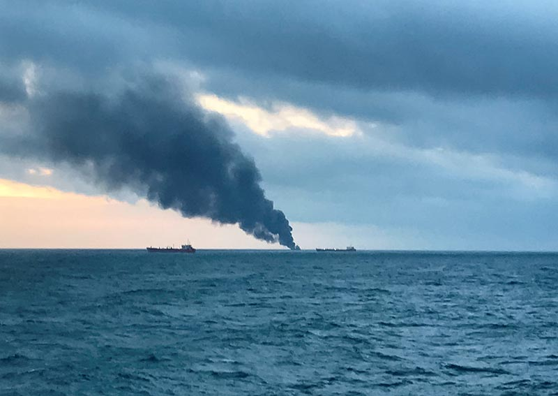 Smoke rises from a fire at a ship in the Kerch Strait near Crimea January 21, 2019.  Photo: Reuters
