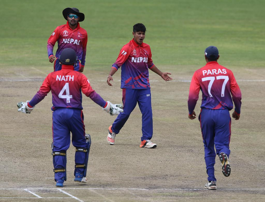 Nepali leg spinner Sandeep Lamichhane celebrates with team mates at ICC Academy in Dubai. Nepal leveled the series 1-1- with amazing display. Photo: ICC