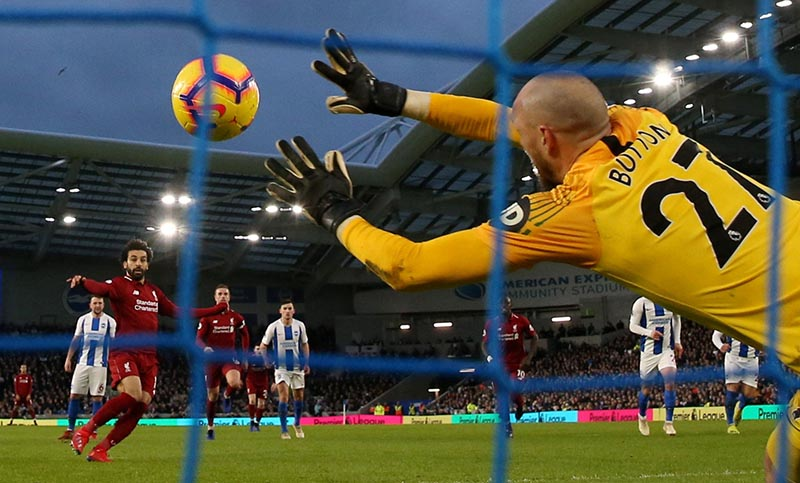 Liverpool's Mohamed Salah scores their first goal from the penalty spot during the Premier League match between Brighton & Hove Albion and Liverpool, at The American Express Community Stadium, in Brighton, Britain, on January 12, 2019. Photo: Action Images via Reuters