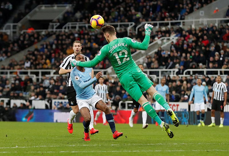 Newcastle United's Martin Dubravka in action with Manchester City's Raheem Sterling during the Premier League match between Newcastle United and Manchester City, at St James' Park, in Newcastle, Britain, on January 29, 2019. Photo: Action Images via Reuters