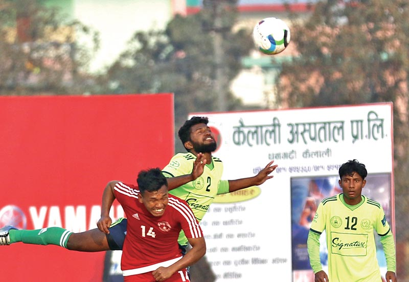NPCu2019s Nir Kumar Rai (left) and MMCu2019s Mohammad Asif jump for a header during their quarter-final match of the third Nepal Ice Farwest Khaptad Gold Cup at the Dhangadhi Stadium on Sunday. Photo: THT