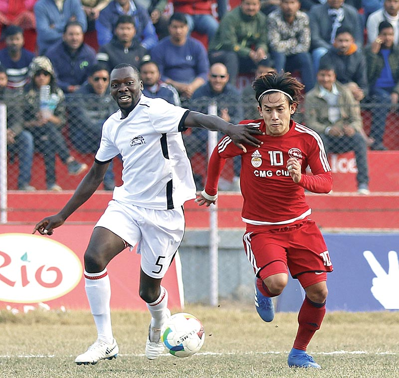 CMG Club Sankatau2019s Subash Gurung (right) vies for the ball with Dauphinsu2019 Biyik during their third Nepal Ice Farwest Khaptad Gold Cup match in Dhangadhi on Tuesday. Photo: THT