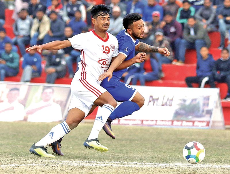 Bikash Rai of Kakarvitta and Ranjan Bista of Three Star (right) vie for the ball during their third Nepal Ice Farwest Khaptad Gold Cup match in Dhangadhi on Wednesday. Photo: THT