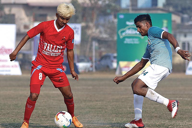 Hemant Thapa Magar of Valley Chyasal Youth Club (left) tries to beat past Delhi FC player during their Farwest Khaptad Gold Cup match in Dhangadhi onu00a0 Thursday. Photo: THT