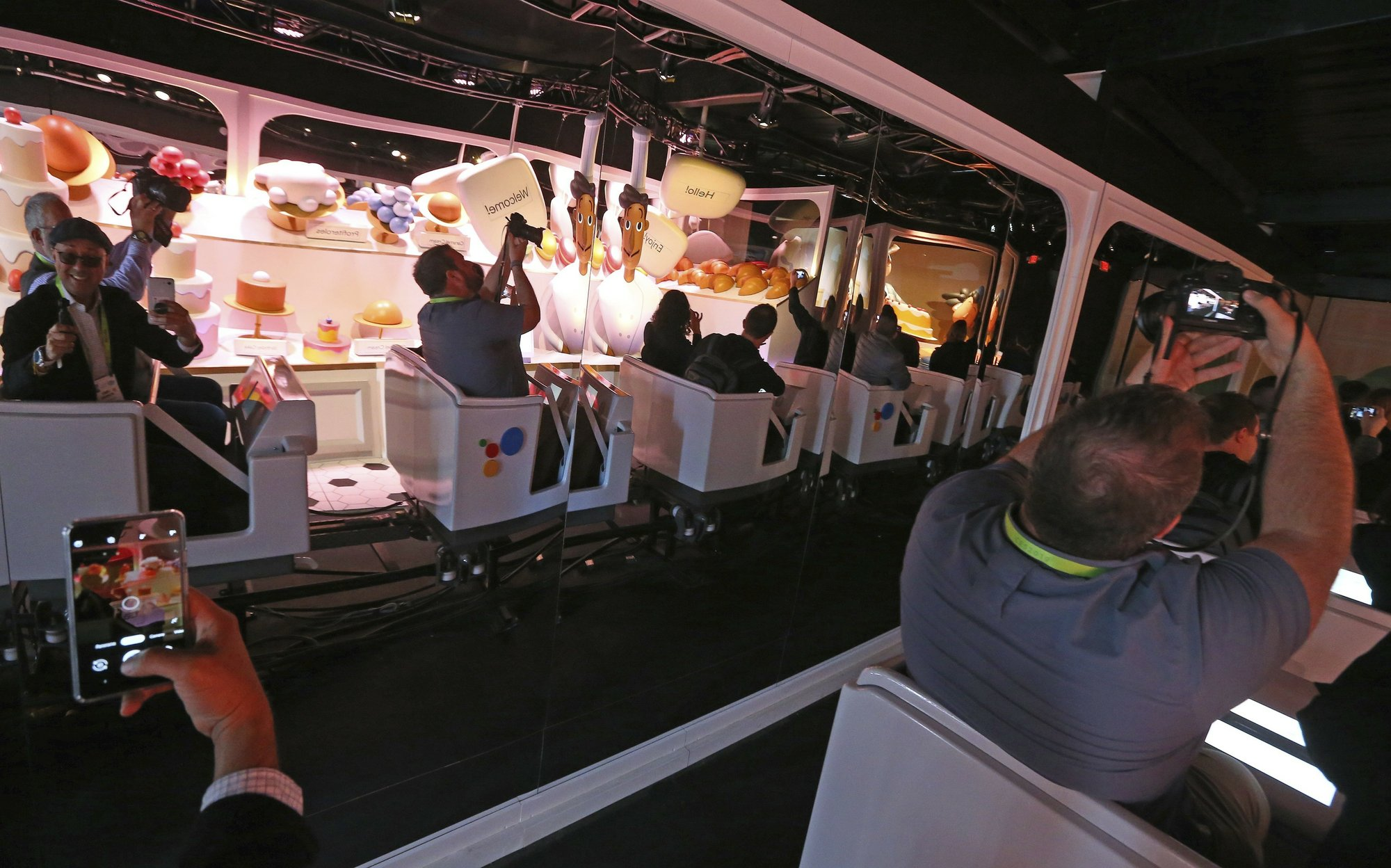 The Google Assistant ride shows off the new features in its voice-enabled digital assistant as visitors ride along at the Google display area at CES International on Tuesday, Jan. 8, 2019, in Las Vegas. Photo: AP