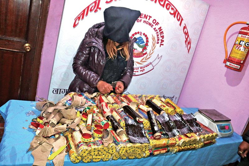 Woman held for trying to smuggle hashish being made public at Narcotics Control Bureau, in Kathmandu, on Wednesday, January 16, 2019. Photo:THT