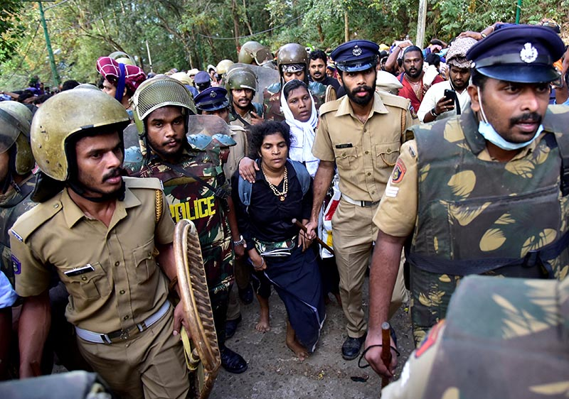 Bindu Ammini, 42, and Kanaka Durga, 44, are escorted by police after they attempted to enter the Sabarimala temple in Pathanamthitta district in the southern state of Kerala, India, December 24, 2018. Picture taken December 24, 2018. Photo: Reuters