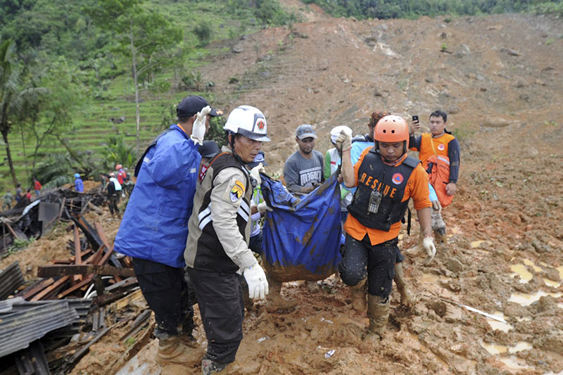 Seasonal rains and high tides in recent days have caused dozens of landslides and widespread flooding across much of Indonesia