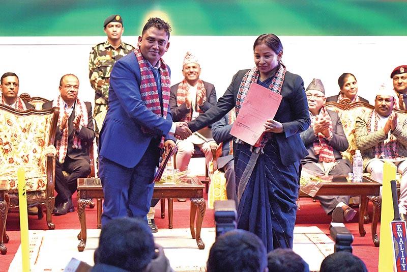 President of Dhurmus Suntali Foundation Sitaram Kattel exchanges the MoU with Mayor of Bharatpur Metropolitan City Renu Dahal during a programme at City Hall in Kathmandu on Wednesday. Photo: THT